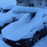 My car and glider covered with snow