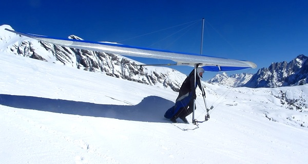 Ready to take off from a black ski piste
